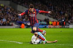 Man City Defender Martin Demichelis (ARG) fouls Barcelona Midfielder Lionel Messi (ARG) on the edge of the box leading to a is shown a red card by card fot the City player and a penalty for Messi - Photo mandatory by-line: Rogan Thomson/JMP - Tel: 07966 386802 - 18/02/2014 - SPORT - FOOTBALL - Etihad Stadium, Manchester - Manchester City v Barcelona - UEFA Champions League, Round of 16, First leg.
