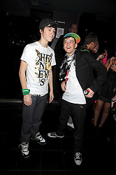 Left, singer LIL' CHRIS and GEORGE SAMPSON at the launch party of the Nokia 5800 phone held at PUNK 14 Soho Street, London W1 on 27th January 2009.