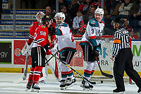 KELOWNA, CANADA - MARCH 2: Schael Higson #21 of the Kelowna Rockets puts his glove in the face of Clay Hanus #58 of the Portland Winterhawks to retaliate the same move on Dalton Gally #3 of the Kelowna Rockets  on March 2, 2019 at Prospera Place in Kelowna, British Columbia, Canada.  (Photo by Marissa Baecker/Shoot the Breeze)