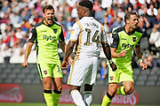 Exeter City forward Lee Holmes (10) taunts MKDons forward Kieran Agard (14) after his penalty miss during the EFL Sky Bet League 2 match between Milton Keynes Dons and Exeter City at stadium:mk, Milton Keynes, England on 25 August 2018.