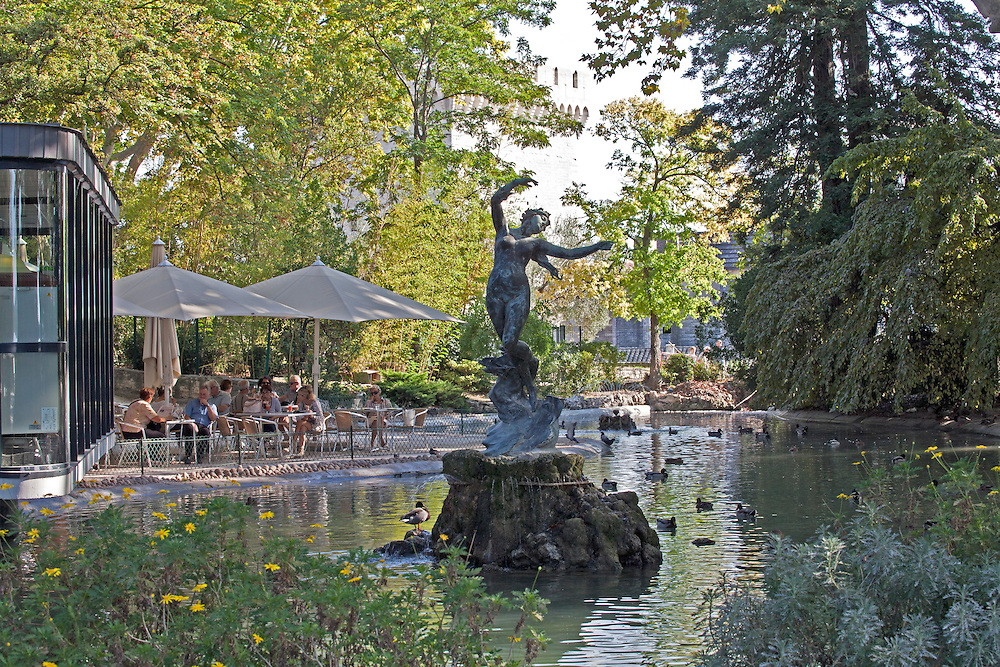 """Venus with Swallows"" by sculptor Felix Charpentier centers a cooling pondadjacent to the open air cafe in the heart of the Rochers des Doms, a botanical and ornamental garden on a high promentory in Avignon, overlooking the Rhome River."