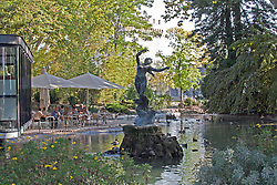 """""""Venus with Swallows"""" by sculptor Felix Charpentier centers a cooling pondadjacent to the open air cafe in the heart of the Rochers des Doms, a botanical and ornamental garden on a high promentory in Avignon, overlooking the Rhome River."""