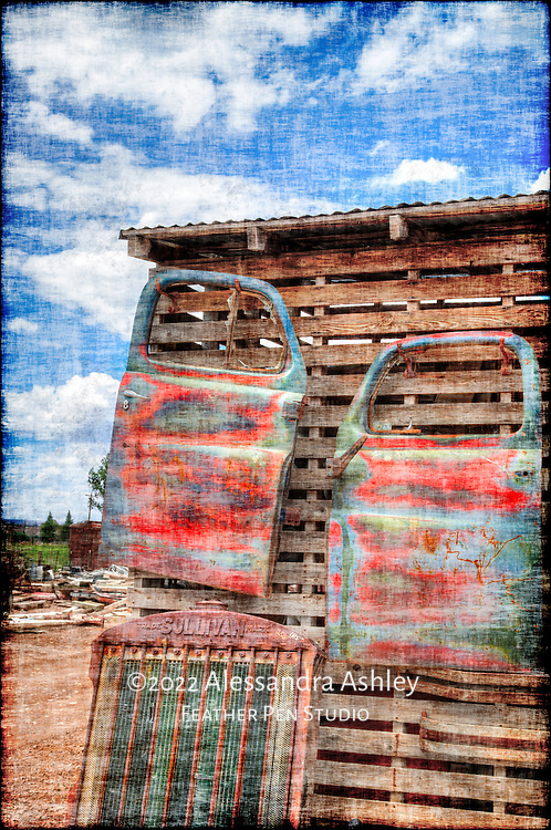 Spare doors and assorted parts of vintage trucks, found in Southwestern Colorado.  High dynamic range image with grunge texture.