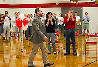 Laconia High School English teacher Tate Aldrich approaches the podium moments after being named the 2017 New Hampshire Teacher of the Year on Friday afternoon.   (Karen Bobotas/for the Laconia Daily Sun)