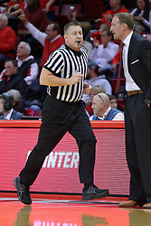 29 December 2016:  Ray Natili runs down the sideline passing Dan Muller, Head Coach during an NCAA  MVC (Missouri Valley conference) mens basketball game between the Evansville Purple Aces the Illinois State Redbirds in  Redbird Arena, Normal IL