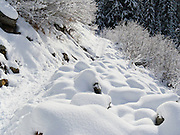 Snow Lake trail is a snowshoe path through sensuous snow mounds in early December at Snoqualmie Pass, Washington, USA