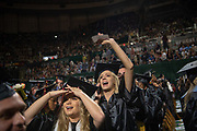 Megan Wheeler waves to supporters at spring undergraduate commencement. Photo by Ben Siegel