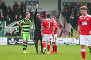 Wrexham's James Jennings(3) is shown a yellow card, booked for a tackle on Forest Green Rovers Charlie Cooper(20) during the Vanarama National League match between Forest Green Rovers and Wrexham FC at the New Lawn, Forest Green, United Kingdom on 18 March 2017. Photo by Shane Healey.