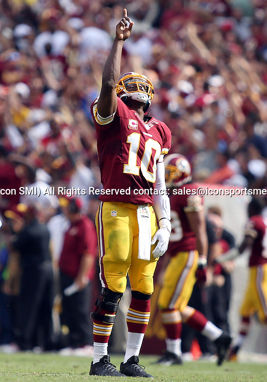 September 22, 2013: Washington Redskins Quarterback Robert Griffin III (10) prays during a regular season match between the Detroit Lions and the Washington Redskins at FedEx Field in Landover, Maryland.