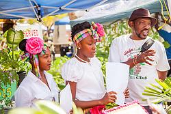 "(L-R) Phurah Petersen, Amaya Chesterfield, and Vincent Henley of the Gladys Abraham Garden Club.  ""Alvin's Cultural Workshop"" Cultural Fair honoring Mr. Alvin Turnbull.  Emancipation Garden.  St. Thomas, VI.  29 April 2015.  © Aisha-Zakiya Boyd"