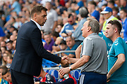 Middlesbrough manager Jonathan Woodgate  shakes hands with Cardiff City manager Neil Warnock before the EFL Sky Bet Championship match between Cardiff City and Middlesbrough at the Cardiff City Stadium, Cardiff, Wales on 21 September 2019.
