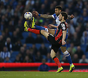 AFC Bournemouth midfielder Harry Arter and Leon Best, Brighton striker during the Sky Bet Championship match between Brighton and Hove Albion and Bournemouth at the American Express Community Stadium, Brighton and Hove, England on 10 April 2015.