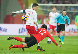 March 27, 2018 - Chorzow, Poland - Robert Lewandowski of Poland vies Joo-ho Park (KOR),   during the international friendly soccer match between Poland and South Korea national football teams, at the Silesian Stadium in Chorzow, Poland on 27 March 2018. (Credit Image: © Foto Olimpik/NurPhoto via ZUMA Press)