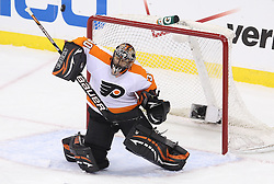 May 3, 2012; Newark, NJ, USA;  Philadelphia Flyers goalie Ilya Bryzgalov (30) makes a save during the first period in game three of the 2012 Eastern Conference semifinals at the Prudential Center.