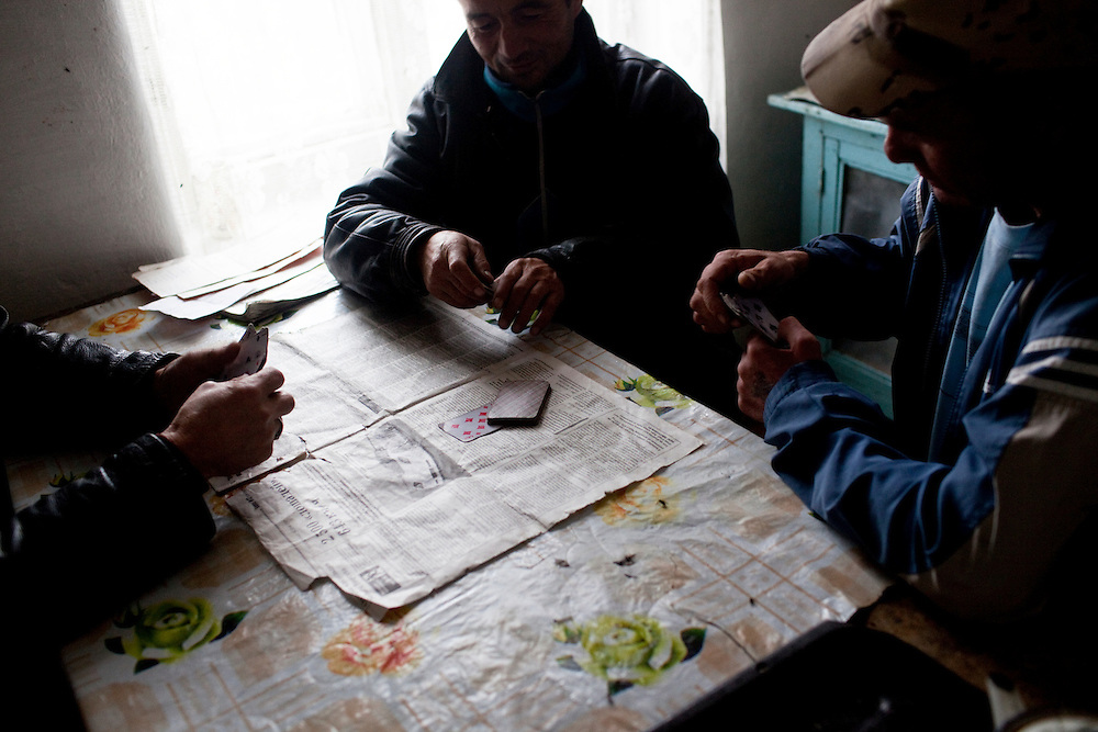 CREDIT: DOMINIC BRACCO II..SLUG:PRJ/KAZAKHSTAN SHEEP HERDERS..DATE:10/21/2009..CAPTION:Sheepherders play cards at their home in northern Kazakhstan. The herders live near a radio active lake which was made during the 1970s as part of an experiment by the USSR to create lakes from atomic bombs. The lake is in an area known as The Polygon, a test site for more than 400 of the Soviet Union's nuclear weapons.