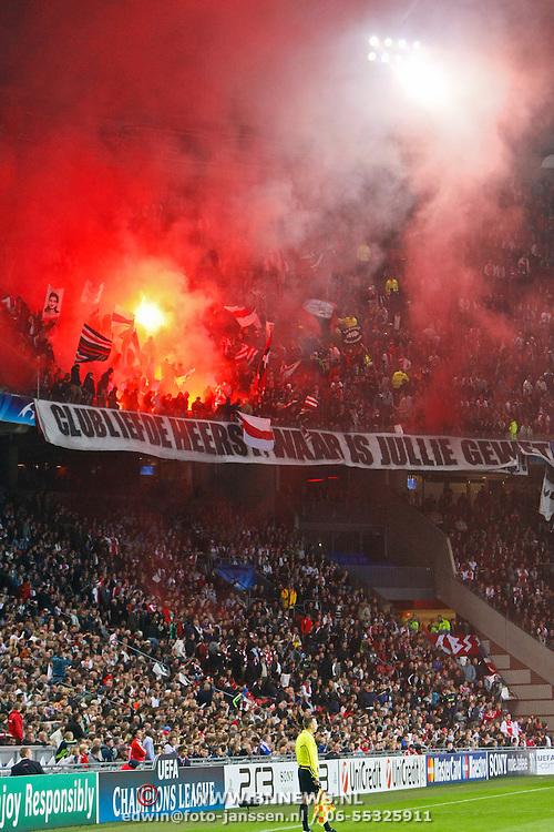 NLD/Amsterdam/20100928 - Champions Leaguewedstrijd Ajax - AC Milan, vuurwerk op de tribune van ajaxfans met protest tegen de hoge entreekosten
