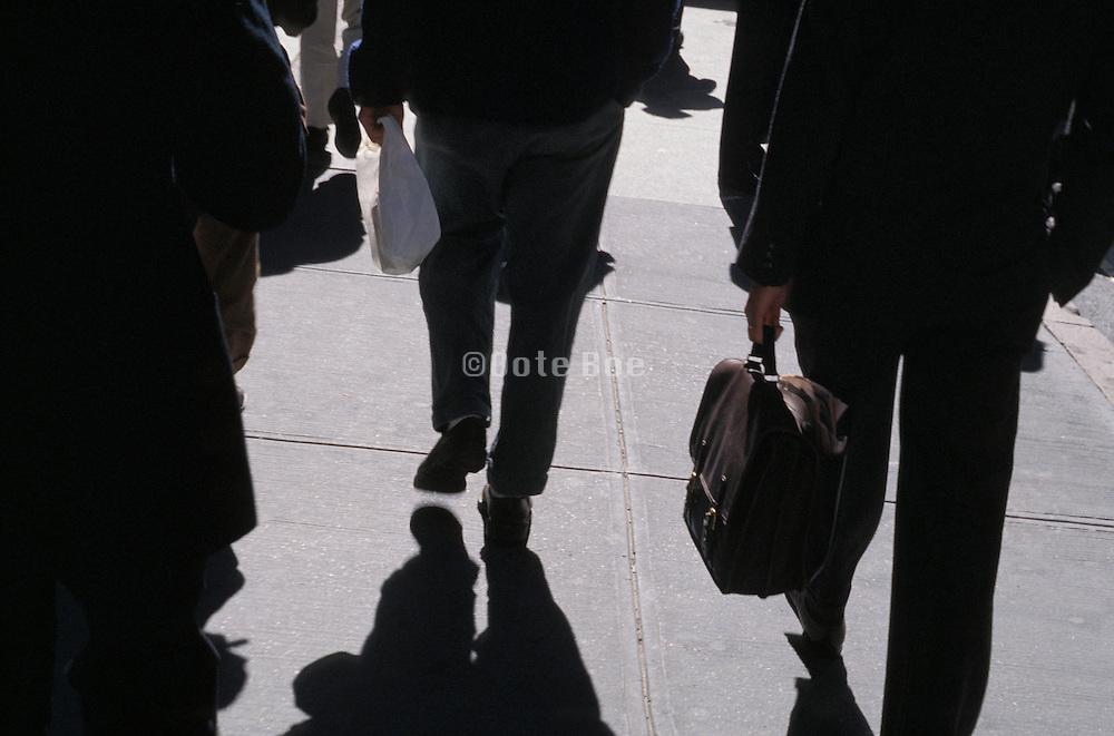 businessmen walking in city environment