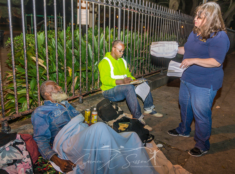 UNITY outreach workers Kathleen North, right, and Clarence White, center, try to determine how much assistance James Watson will need, Nov. 11, 2015, in New Orleans, Louisiana. Watson, 57, has been homeless for 10 years and was found sleeping at Washington Square. UNITY, a 60-agency coalition, provides housing and services for people who are homeless. (Photo by Carmen K. Sisson/Cloudybright)