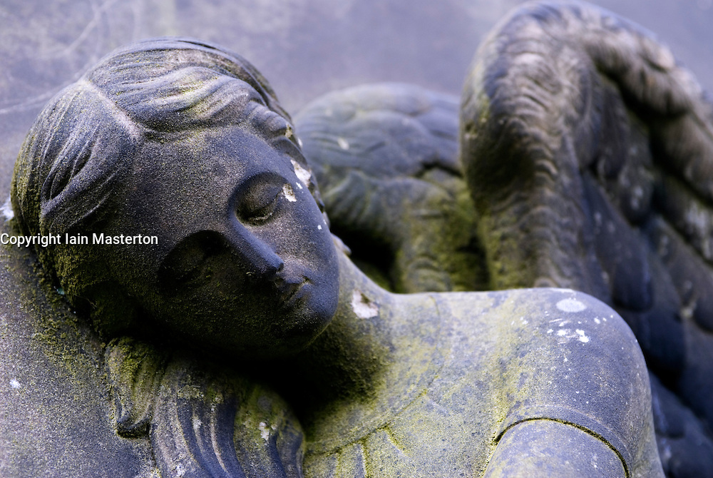 Detail of carved angel sculpture on headstone at historic Necropolis cemetery in Glasgow Scotland