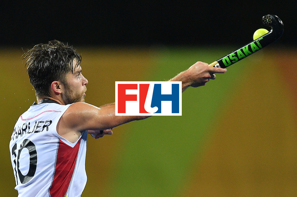 Belgium's Cedric Charlier hits the ball during the men's semifinal field hockey Belgium vs Netherlands match of the Rio 2016 Olympics Games at the Olympic Hockey Centre in Rio de Janeiro on August 16, 2016. / AFP / Carl DE SOUZA        (Photo credit should read CARL DE SOUZA/AFP/Getty Images)
