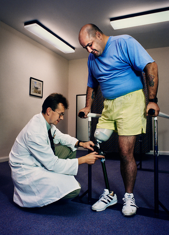 The Artificial Limb and Appliance Centre, based in the Specialist Rehabilitation Centre at Morriston Hospital, Swansea, South Wales.<br /> <br /> A prosthetist makes some adjustments to an amputee's artificial limb.