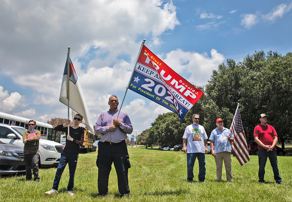 """Trump supporters at a """"Save America Rally"""" in Baton Rouge on the 4th of July across the street from the Governor's Mansion where about 200 gathered. The 4th of July rally was organized by Jeff Crouer, Mimi Owens and Woody Jenkins, chairman of the executive committee for the Republican Party in East Baton Rouge Parish. Rev. Tony Spell of Life Tabernacle Church who has held church services in defiance of a stay-at-home order throughout the pandemic was one of the speakers. He an other speakers expressed their displeasure of being told to wear a mask to prevent the spread of Covid-19 and the removal of confederate monuments."""