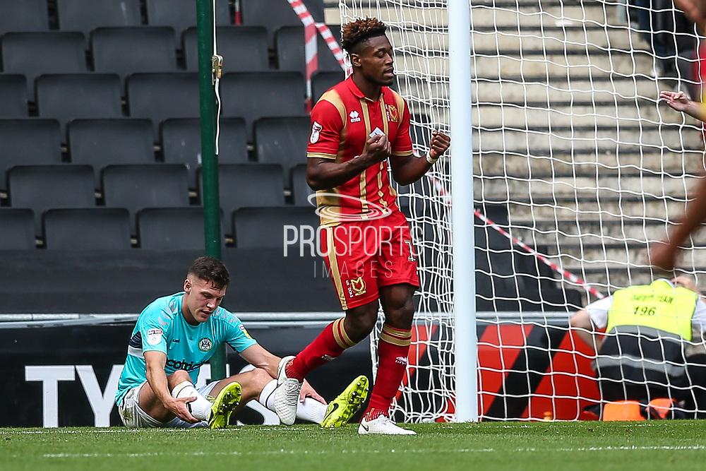 Milton Keynes Dons Chuks Aneke(10) scores a goal 1-0 and celebrates during the EFL Sky Bet League 2 match between Milton Keynes Dons and Forest Green Rovers at stadium:mk, Milton Keynes, England on 15 September 2018.