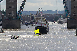 London Bridge, London, June 15th 2016. A flotilla of fishing boats led by UKIP's Nigel Farage heads through Tower Bridge in protest against the EU's Common Fisheries Policy and in support of Britain leaving the EU. PICTURED: A remain campaigner's boat crosses the bows of a trawler as it enters the Pool of London.