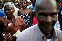 A woman holds a candle in the crowd at a religious parade in Quibdo, the capital of the state of Choco, on October 4, 2006. Choco is a state that has suffered terribly at the hands of both rightwing paramilitaries and leftist rebels over the years, causing many to flee to other parts of Colombia. The Choco is located on the Pacific coast of Colombia and most of the people are black descendants of African slaves. (Photo/Scott Dalton)