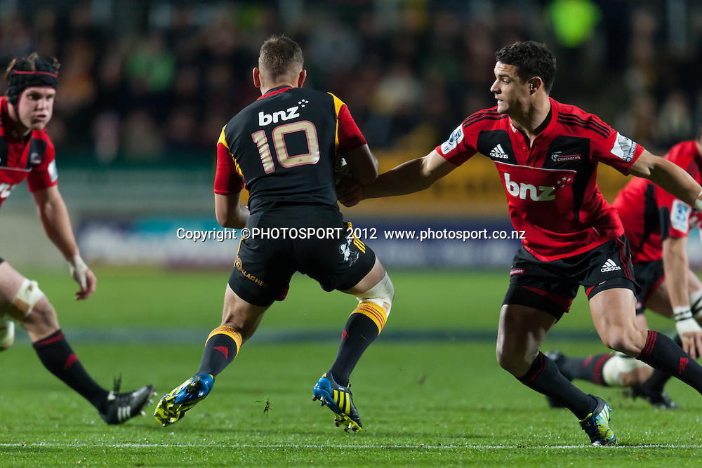 Chiefs' Aaron Cruden comes up against his opposite Dan Carter during the Super Rugby Semi Final won by the Chiefs (20-17) against the Crusaders at Waikato Stadium, Hamilton, New Zealand, Friday 27 July 2012. Photo: Stephen Barker/Photosport.co.nz