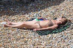 © Licensed to London News Pictures. 03/06/2017. Brighton, UK. Members of the public enjoy the sunny but windy weather by spending the Saturday afternoon on the beach in Brighton and Hove. Photo credit: Hugo Michiels/LNP