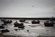 Fishing boats sit on the sand in a dry harbour due to the tide being out. Folkestone Harbour, Kent, United Kingdom. (photo by Andrew Aitchison / In pictures via Getty Images)