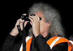 © Licensed to London News Pictures. 06/09/2013. Eldersfield, Gloucestershire, UK. Brian May uses night vision optics while visiting the badger culling zone in West Gloucestershire to lend support to the campaign against the cull.  Brian is an outspoken opponent of the badger cull and has a charity called Save Me.  The Government has licensed a pilot badger cull as part of efforts to reduce boving turberculosis in cows on farms.  06 September 2013.<br /> Photo credit : Simon Chapman/LNP