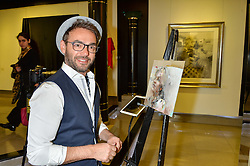 Artist CHRISTIAN HOOK at a private view of work by Christian Hook in aid of Children in Crisis held at Clarendon Fine Art, 46 Dover Street, London on 17th March 2016.
