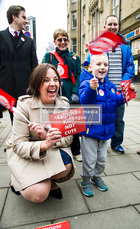 Pictured: Kezia Dugdale met Lewis Paterson (aged 4) as she started the election campaign in earnest, wathced by Local candidate Daniel Johnston, Mary Paterson and her son Iain Paterson (Father of Lewis)<br /> <br /> Scottish Labour leader, Kezia Dugdale began her Party's Holyrood election campaign by joining supporters at a street stall in Morningside in Edinburgh today. She was joned by local candidate Daniel Johnston<br /> <br />  Ger Harley | EEm 23 March 2016