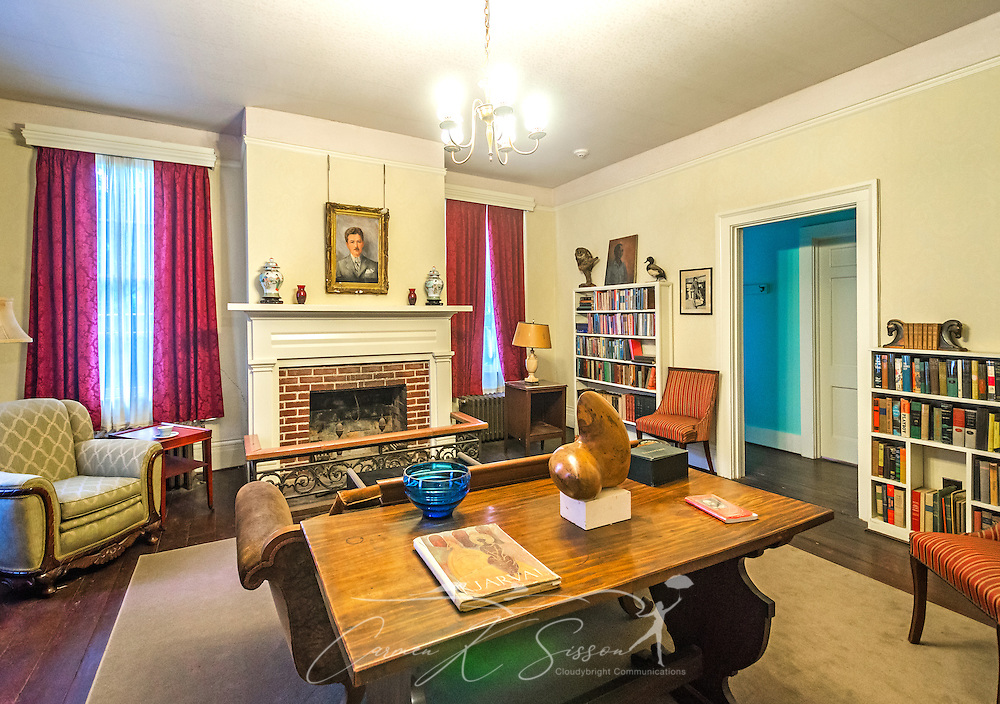 William Faulkner's library is pictured at his home at Rowan Oak, May 30, 2015, in Oxford, Mississippi. The room was originally his writing room until his study was built in 1952. Faulkner built the bookcases himself. The painting of Faulkner above the fireplace was painted by his mother, Maud Butler Faulkner. (Photo by Carmen K. Sisson/Cloudybright)