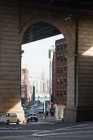 empire state viewed through manhattan bridge - New York City in October 2008