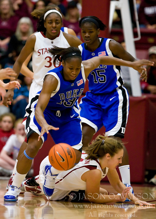 December 15, 2009; Stanford, CA, USA;  Duke Blue Devils guard/forward Karima Christmas (13)  steals the ball from Stanford Cardinal forward Kayla Pedersen (14) during the second half at Maples Pavilion.  Stanford defeated Duke 71-55.
