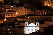 Highlighted church of São Cristovão e São Lourenço, at Mouraria district in central Lisbon.