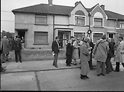 """John O'Grady Rescued By Gardai.   (R67)..1987..05.11.1987..11.05.1987..5th November 1987..After being kidnapped from his home in Cabinteely, Co Dublin, John O'Grady was finally rescued after twenty one days in captivity. he was located in a house inCarnlough Road, Cabra West, Dublin. During his ordeal Mr O""""Grady was mutilated by the kidnappers led by Dessie O'Hare to apply pressure on his family to pay the ransom sought. In an ensuing gun battle with the kidnappers a detective garda was shot and seriously wounded. In the chaos that followed the kidnappers escaped and were not all captured for a further three weeks after a massive manhunt...Image shows reporters surrounding one of the Gardai directly involved in the rescue of John O'Grady."""