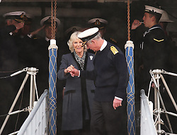 The Prince of Wales holds the hand of his wife Duchess of Cornwall as they leave HMS Illustrious in Portsmouth, United Kingdom, Wednesday, 26th February 2014. Picture by Stephen Lock / i-Images