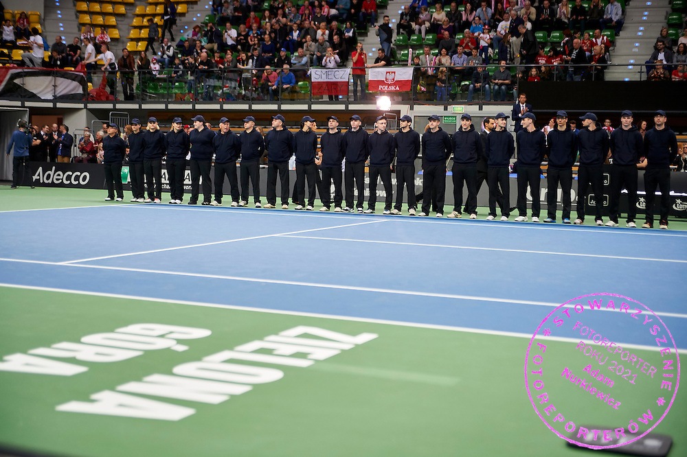 Linemen referees while opening ceremony during the Fed Cup / World Group Play Off tennis match between Poland and Switzerland on April 18, 2015 in Zielona Gora, Poland<br /> Poland, Zielona Gora, April 18, 2015<br /> <br /> Picture also available in RAW (NEF) or TIFF format on special request.<br /> <br /> For editorial use only. Any commercial or promotional use requires permission.<br /> <br /> Adam Nurkiewicz declares that he has no rights to the image of people at the photographs of his authorship.<br /> <br /> Mandatory credit:<br /> Photo by &copy; Adam Nurkiewicz / Mediasport