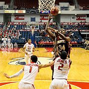 Denver's forward, Chris Udofia (34), shoots over South Alabama's guard Trey Anderson (1) and Dallas Jones (2) in the first half of play in Mobile, AL. Denver defeated South Alabama 67-50 on January 7, 2012.