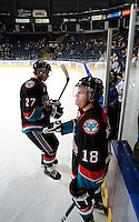 KELOWNA, CANADA, OCTOBER 11: Jessey Astles #27 and Shane McColgan #18 of the Kelowna Rockets head to the dressing room after warm-up  as the Medicine Hat Tigers visited the Kelowna Rockets on October 11, 2011 at Prospera Place in Kelowna, British Columbia, Canada (Photo by Marissa Baecker/shootthebreeze.ca) *** Local Caption ***Jessey Astles;Shane McColgan;