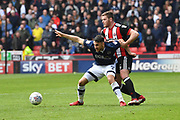Millwall FC forward Lee Gregory (9) and Sheffield United defender Jack O'Connell (5) during the EFL Sky Bet Championship match between Sheffield United and Millwall at Bramall Lane, Sheffield, England on 14 April 2018. Picture by Ian Lyall.