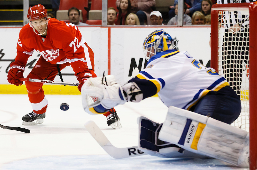 Mar 22, 2015; Detroit, MI, USA; Detroit Red Wings right wing Erik Cole (72) takes a shot on St. Louis Blues goalie Jake Allen (34) in the first period at Joe Louis Arena. Mandatory Credit: Rick Osentoski-USA TODAY Sports