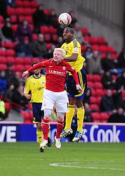 Bristol City's Marvin Elliott battles for the high ball with Barnsley's David Perkins - JMP - 29/10/11 - Oakwell Stadium - Barnsley, England - Barnsley v Bristol City