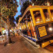 Streetcars at dusk along Powell Street near Ellis, downtown San Francisco, CA.