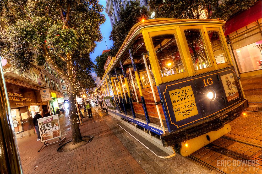 Streetcars at dusk along Powell Street near Ellis, downtown San Francisco, CA.