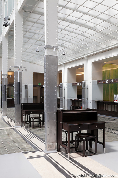 Tapered alumium columns and original furniture. Post Office Savings Bank, Vienna, Austria 1904-12 Architect: Otto Wagner